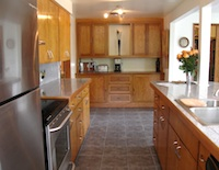 High-end kitchen with stainless steel appliances and granite counters'