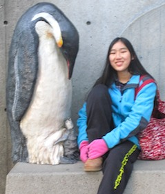 Photo of penguin and friend at Boston's New England Aquarium