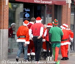 Santas going into Games On sports bar near Boston's Fenway Park
