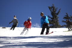 Snowboarders at Attitash, one of the top New England ski areas located in Bartlett, NH