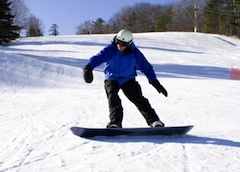 Photo of snow boarder at Camdem Snow Bowl, popular New England ski area near Camden Maine