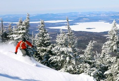 Photo of skier and spectacular scenary at Saddleback Mountain in Maine, one of the top New England ski areas