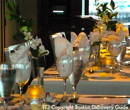 Photo of tables set for dinner on Odyssey, Boston cruise