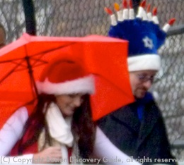 Santa and Menorrah hats being worn in Boston