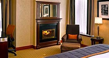 Room with fireplace at the Millennium Bostonian Hotel near Faneuil Market in Boston, MA