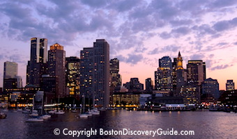Boston skyline on a cloudy night - photographed from boat on Boston Harbor