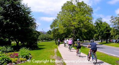 Bike riders in Boston's Fenway neighborhood, near the famous Victory Gardens