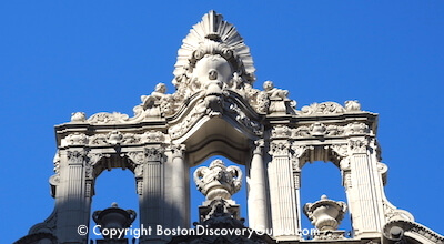 Ornate carvings on top of the Boston Opera House on Washington Street