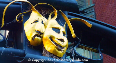 Tragedy/Comedy masks on Tremont Street gateway in Boston's Theatre District