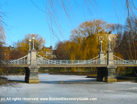 Suspension Bridge over lagoon in Boston Public Garden in winter