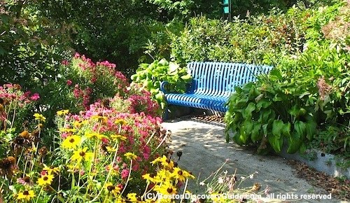 Boston secret parks include Fenway's Ramler Park, filled with flowers, benches, a fountain, and birds.