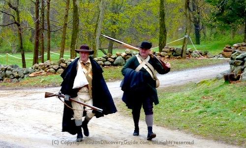 Colonial militia during Patriots' Day reenactment at Minute Man National Historic Park near Boston