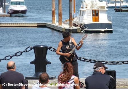 Tupahn performing on Boston waterfront
