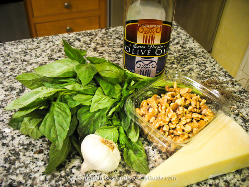 IIngredients for basil pesto: basil, olive oil, garlic, walnuts, asiago cheese