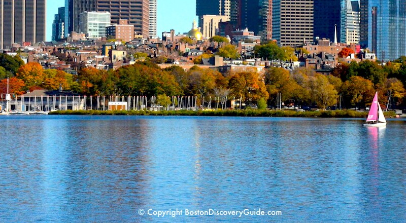 Boston's Beacon Hill neighborhood overlooking the Charles River, with Financial District buildings in the background