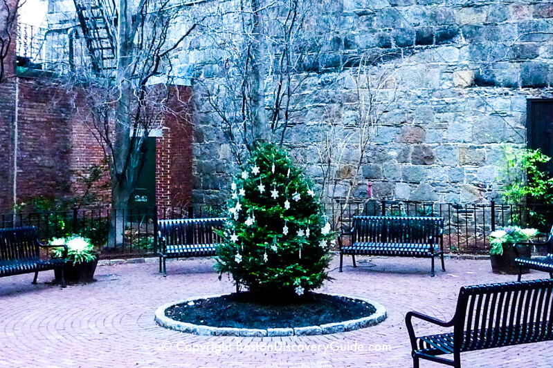 Temple Street Park in December - The gray granite wall is the back of St. John the Evangelist Church
