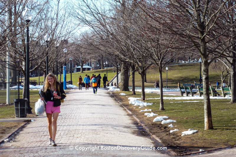 Yes, there's snow on the ground on Boston Common in late March - but the weather is warm enough to wear shorts