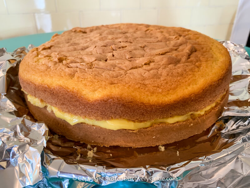 Assembled Boston cream pie ready to be glazed