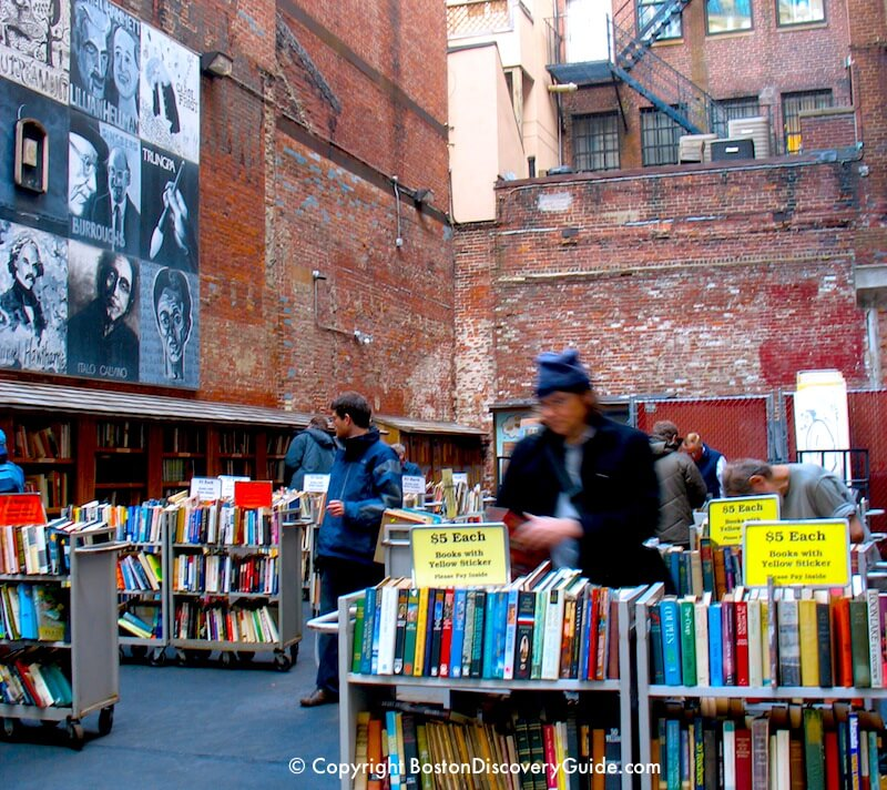 Browsing through books in Brattle Book Store's open air market next to the store