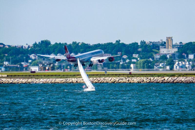 Virgin Airlines flight landing at Boston Logan Airport across from Castle Island