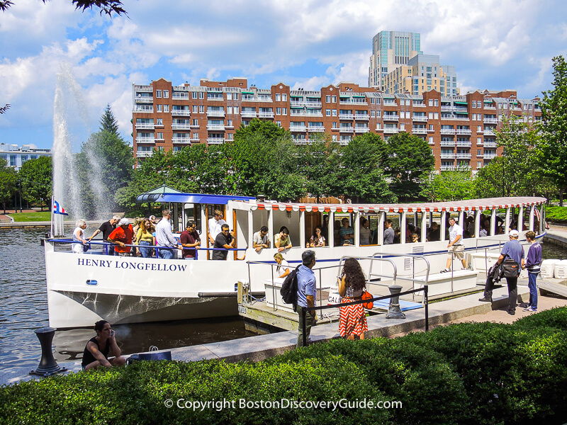 Passengers boarding a Charles Riverboat sightseeing cruise at Lechmere Canal Park