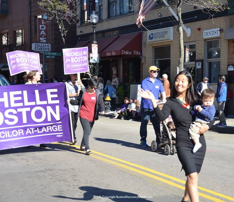Boston City Counciler At-Large Michelle Wu marching down Hanover Street in the Columbus Day Parade