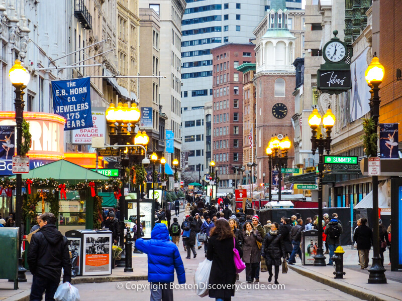 Boston neighborhoods:  Downtown Crossing shoppers, with Old South Meeting House in the background