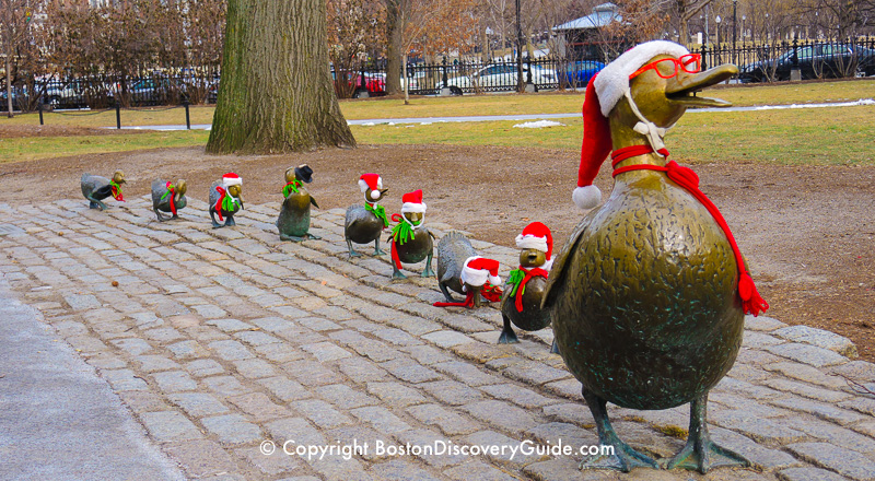 Make Way for Ducklings statues dressed in Santa outfits