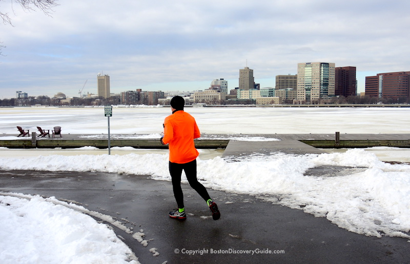 Running along a cleared path on the Esplanade, with the Charles River and Cambridge in the background