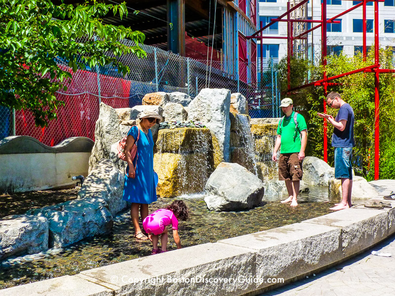Stream with boulders and waterfalls provide another splash area for kids (and adults) in the Chinatown Park