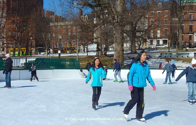Frog Pond ice rink on Boston Common, with beautiful Beacon Hill mansions in the background