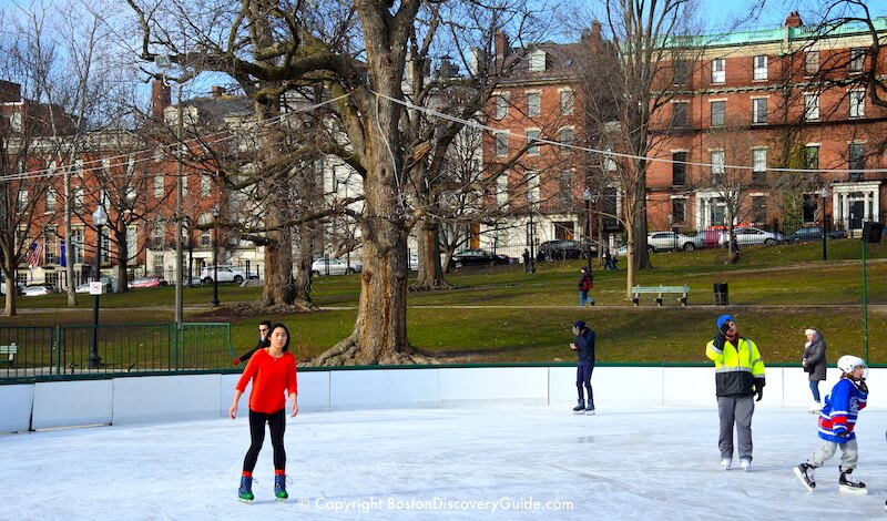 Ice skating (wearing only a sweater) on Frog Pond at Boston Common on a sunny 50-degree day during mid-January