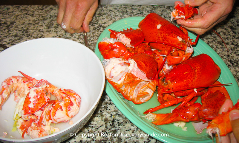 Boiled lobsters being shelled and cut into chunks