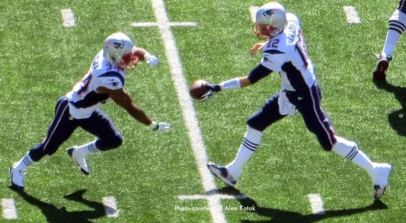 Tom Brady handing off ball