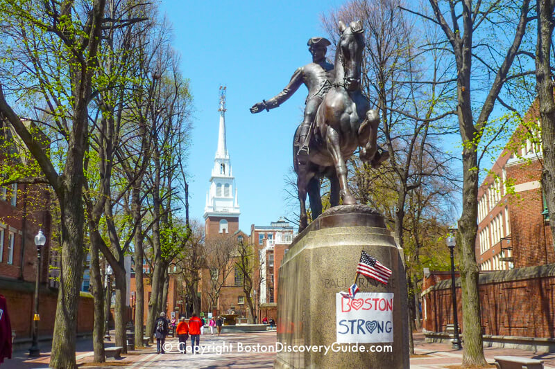 Paul Revere Statue in Boston's North End, with Old North Church in the background