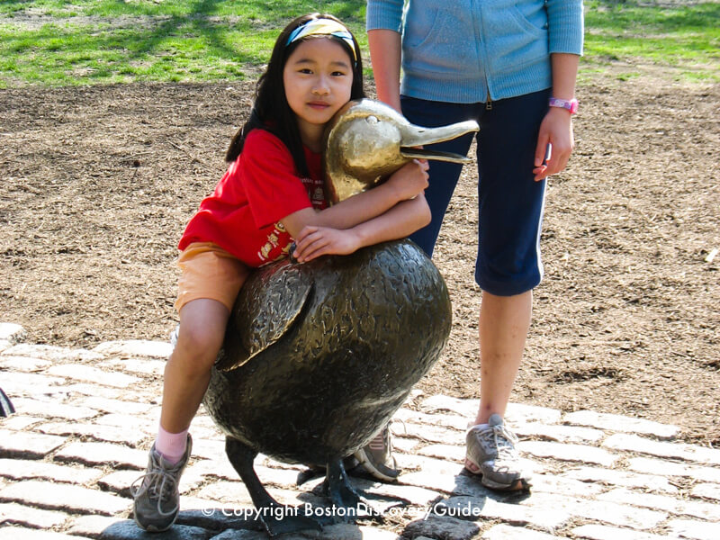 Playing on the Ducklings statue in Boston's Public Garden