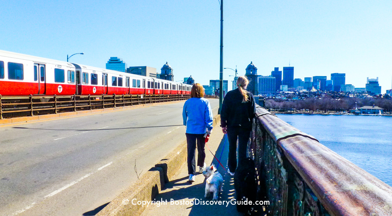 Walkers on the Longfellow Bridge in Boston as a Red Line subway train goes by