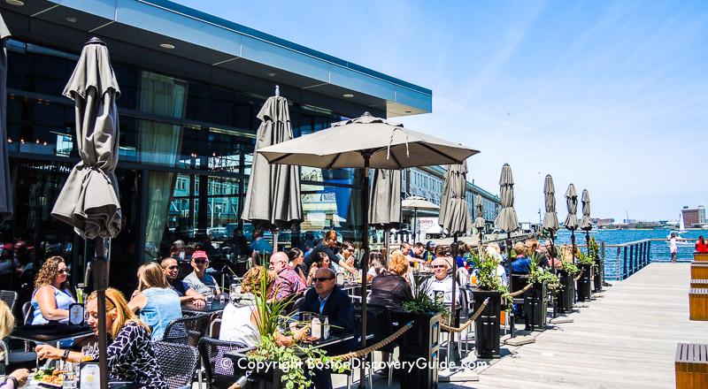 Dining along the South Boston Waterfront overlooking Boston Harbor - the wood walkway next to the restaurant is part of Harborwalk