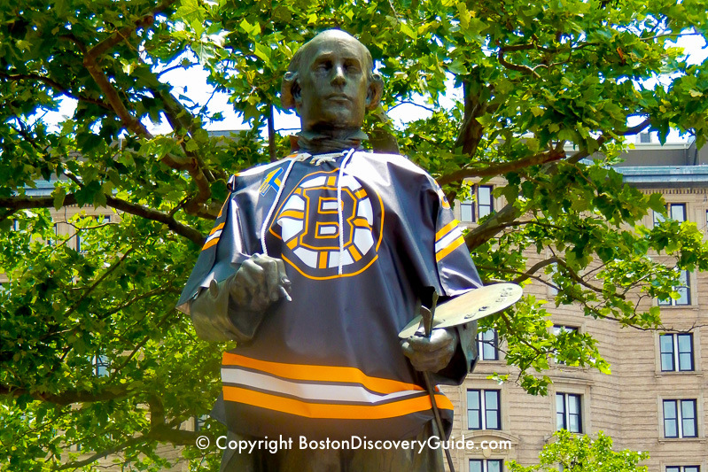John Singleton Copley statue dressed in a Bruins shirt in Boston's Copley Square