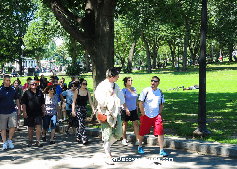 Tour guide leading tour group along Freedom Trail on Boston Common