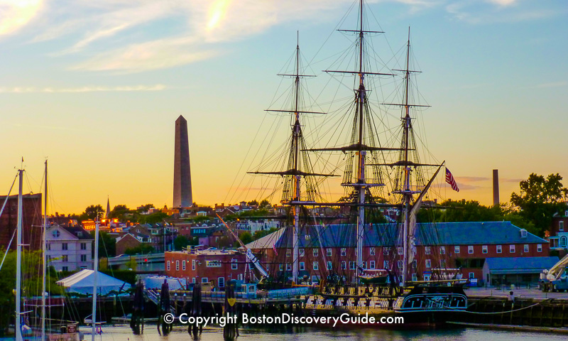 USS Constitution with Bunker Hill Monument in the background