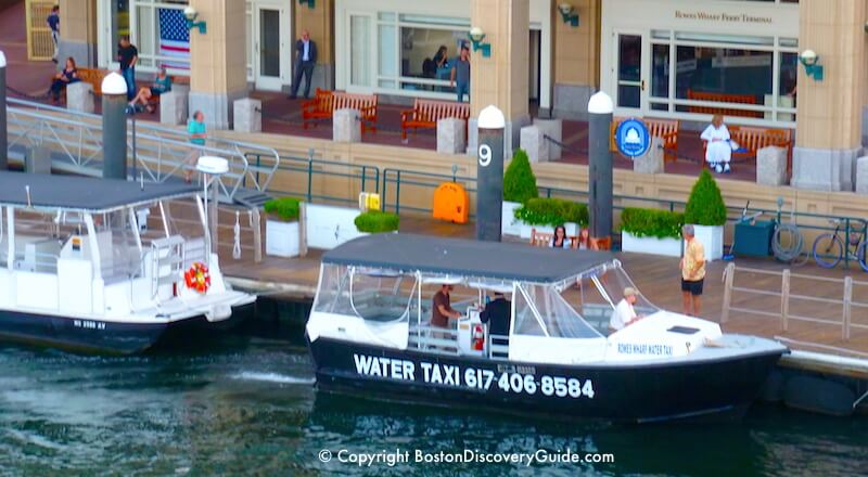 Water taxi at Rowes Wharf next to the Boston Harbor Hotel