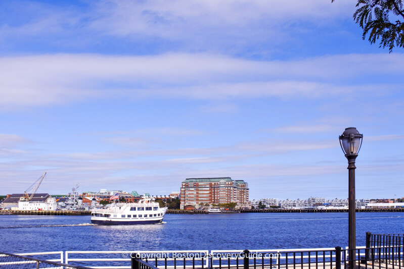 Cruise boat seen from Harborwalk on Boston's Downtown Waterfront