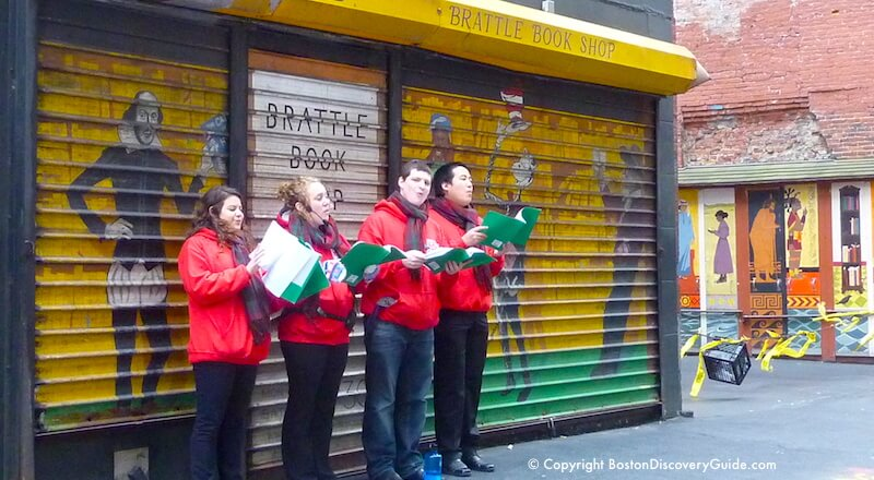 Christmas carolers in front of Brattle Book Store, Boston Massachusetts