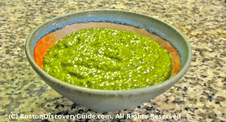 Basil pesto in bowl on kitchen counter