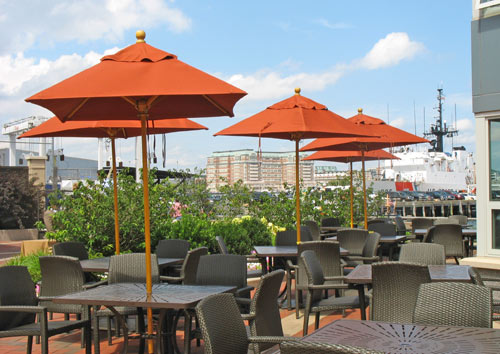 Photo of outdoor dining patio at Battery Wharf Boston hotel