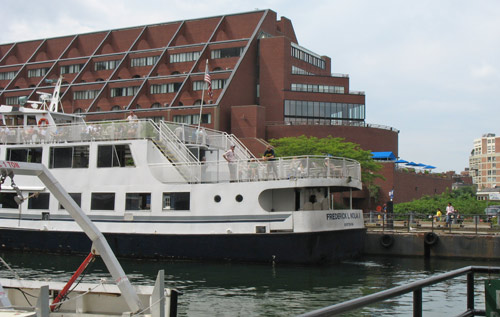 Boston Harbor Cruises passenger boat at Long Wharf next to Marriott Hotel