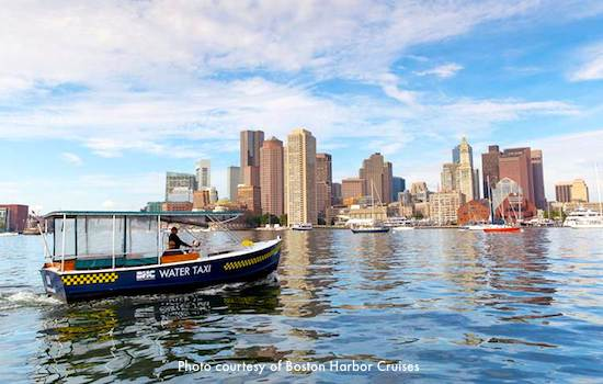 Boston Harbor Cruises water taxi heading from Logan Airport toward Downtown Boston