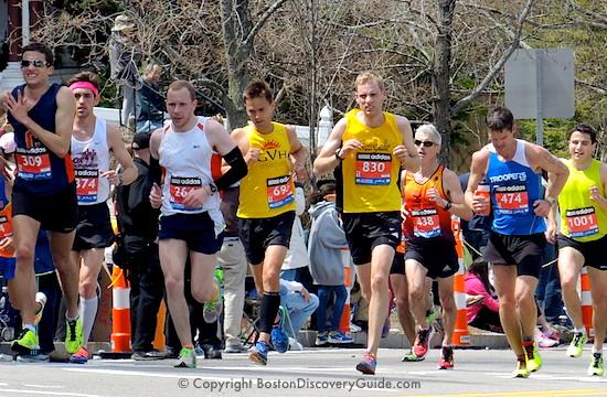 Boston Marathon runners beginning the climb up Heartbreak Hill