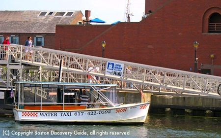 Photo of Boston water taxi at Long Wharf dock waiting for passengers to board / Boston Water Taxi - www.boston-discovery-guide.com